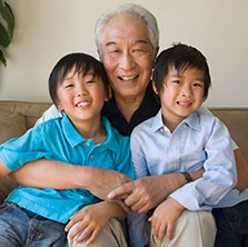 Smiling grandfather with grandchildren
